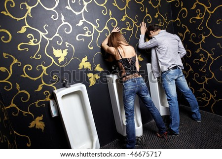 Drunk man and the woman in a night club toilet - stock photo