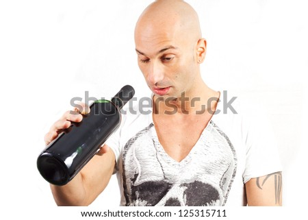 drunk man who looks inside the wine bottle - stock photo