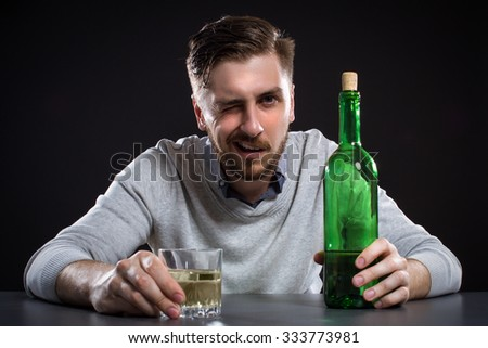 Drunk Man With Bottle On Black Background - stock photo