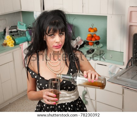 Drunk woman pouring alcohol from a bottle