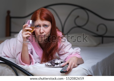 Drunk woman with alcohol in depression - stock photo