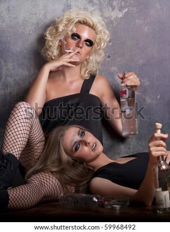 drunk women with cigarette - stock photo