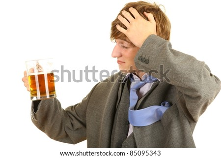 drunk young  businessman in grey suit with beer
