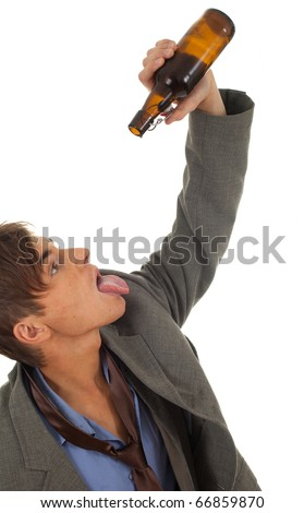 drunk young  businessman in grey suit with bottle of beer
