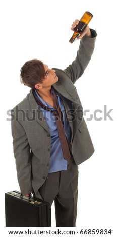 drunk young  businessman in grey suit with briefcase - stock photo