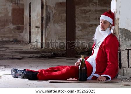 Drunken Homeless Santa Sitting on the Floor - stock photo