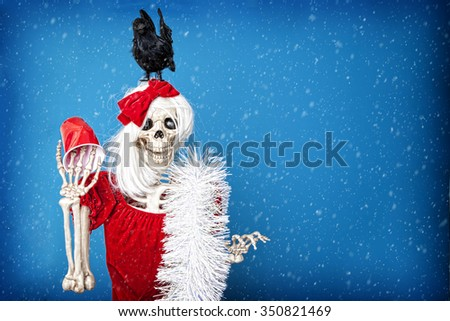 Drunken skeleton celebrating hard at the Christmas party.  See the before picture also in my portfolio. - stock photo