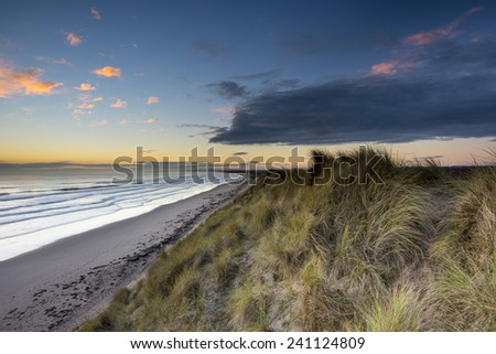 Druridge Bay is a long coastal bay in Northumberland, England, stretching from Amble to Cresswell. Beautiful sandy beach and it's dunes are favourite place to visit at any time of the year.