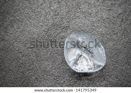 Dry and damaged contact lens on dark background. - stock photo