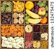 Dry and fresh fruit assortment in rustic wooden box - stock photo