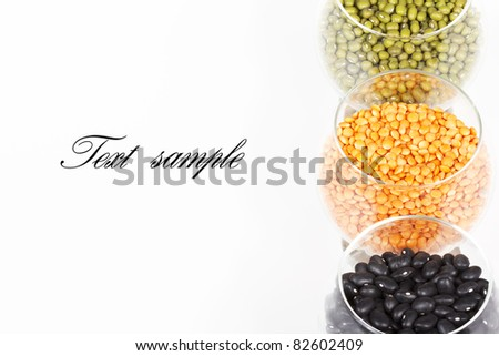 Dry beans on glasses isolated on white - stock photo