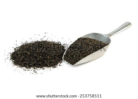 Dry black tea leaves . - stock photo
