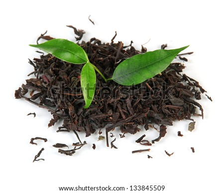 Dry black tea with green leaves, isolated on white - stock photo
