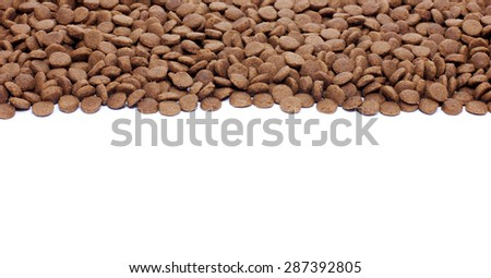 Dry brown pet food (dog or cat) on white background - stock photo