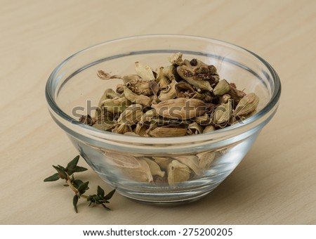 Dry Cardamom heap on the wood background - stock photo