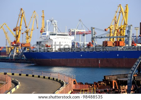 dry cargo ship in port - stock photo