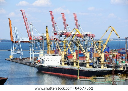 dry cargo ship is unloaded at the port - stock photo