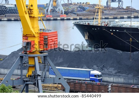 dry cargo ship is unloaded at the port