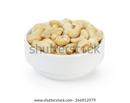 dry cashew nuts in bowl on white - stock photo