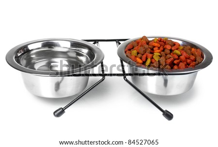 Dry cat food and water in bowls isolated on white - stock photo