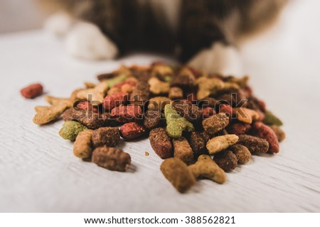 dry cat food, prrr, letters, cat's paw - stock photo