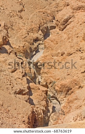 Dry channel in ground cleft of mountain slope. - stock photo