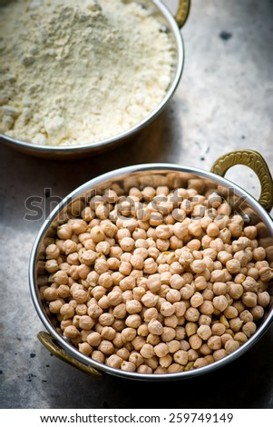 Dry chick-pea in the Indian copper bowl on a metal background. selective focus