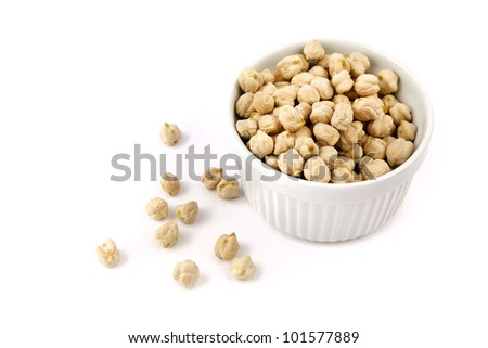 Dry chickpeas in a white bowl, isolated on white - stock photo