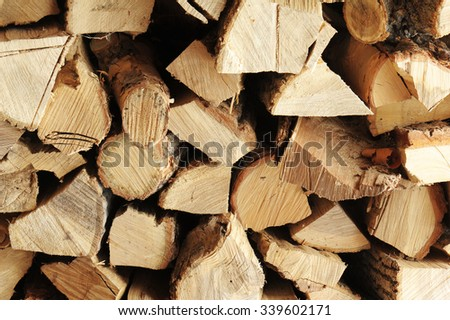 Dry chopped firewood logs in a pile. Nature abstract background with stack of firewood. - stock photo