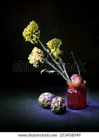 dry chrysanthemum red bottle orange leaf light painting still life - stock photo