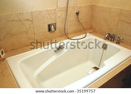 Dry, clean bathtub in a luxurious hotel room