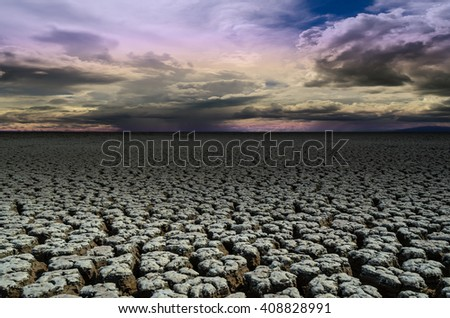 dry cracked earth,Drought land dry and cracked soil in arid season - stock photo