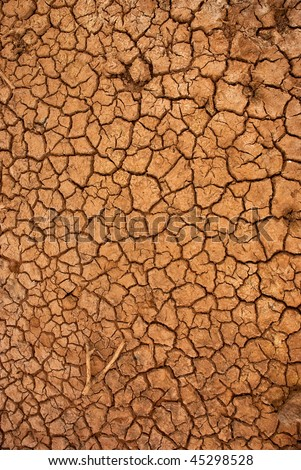 Dry cracked ground filling the frame as background - stock photo