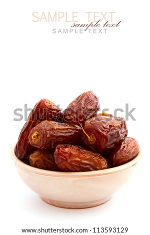 Dry dates in bowl on white background - stock photo