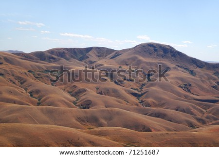 Dry de-forested hills around Morafeno in central Madagascar - stock photo