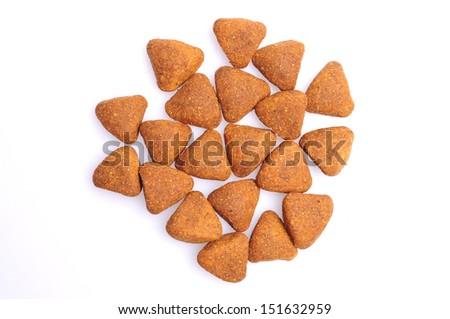 Dry dog food close up, isolated on white background - stock photo