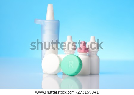 Dry eyes eye drops and contact lens case - stock photo