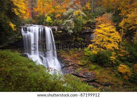 Dry Falls Autumn Waterfalls Highlands NC Forest Fall Foliage in Cullasaja Gorge Blue Ridge Mountains - stock photo