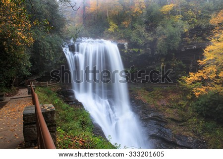 Dry Falls, Upper Cullasaja Waterfall, on a foggy morning in autumn in the Nantahala National Forest, Highlands, North Carolina. - stock photo