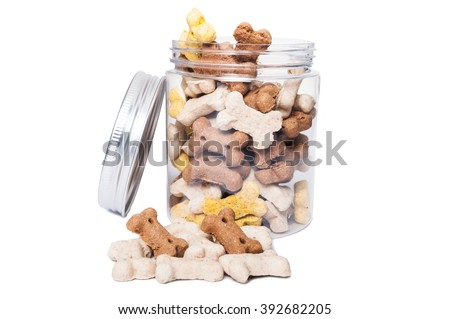 Dry food for dogs in transparent jar isolated on white studio background - stock photo