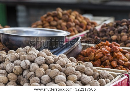 Dry fruits and spices like cashews, raisins, cloves, anise, etc. on display for sale in a bazaar in Osh Kyrgyzstan. - stock photo