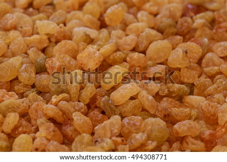 dry golden raisin background, yellow sultana pile