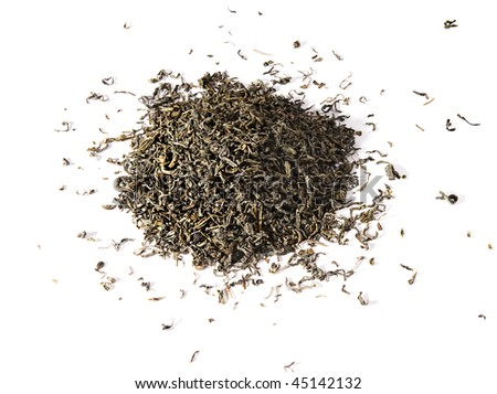 Dry green tea leaves, isolated on a white background