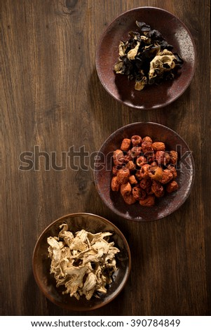 dry  herb Chinese jujube ginger mushroom on brown dish wood table - stock photo