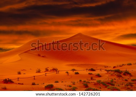Dry Hot Glowing Orange Desert Sand Dunes At Sunset - stock photo