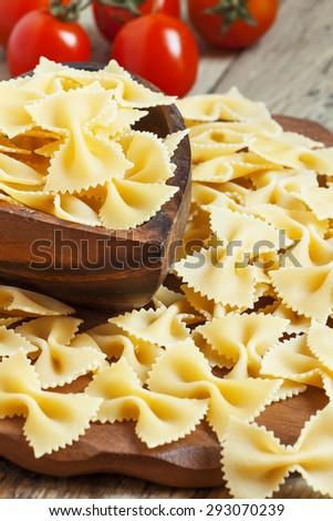 Dry Italian pasta farfalle, selective focus - stock photo