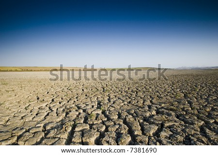 Dry Lake and Deep Blue Sky - stock photo