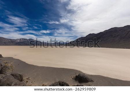 Dry lake floor in desert. Racetrack Playa in Death Valley nation park. Mojave desert. California. USA. - stock photo