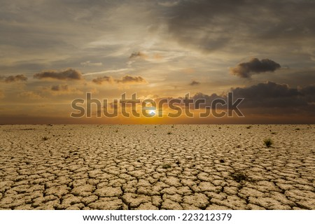 Dry land and the sunset - stock photo