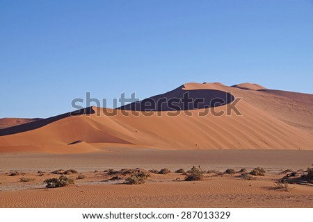 Dry landscape with sand dunes seen in Sossusvlei Park in Namibia - stock photo